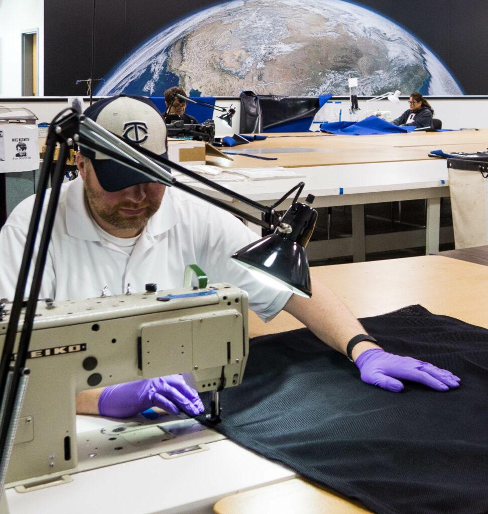 aerospace fabrication employee using machinery